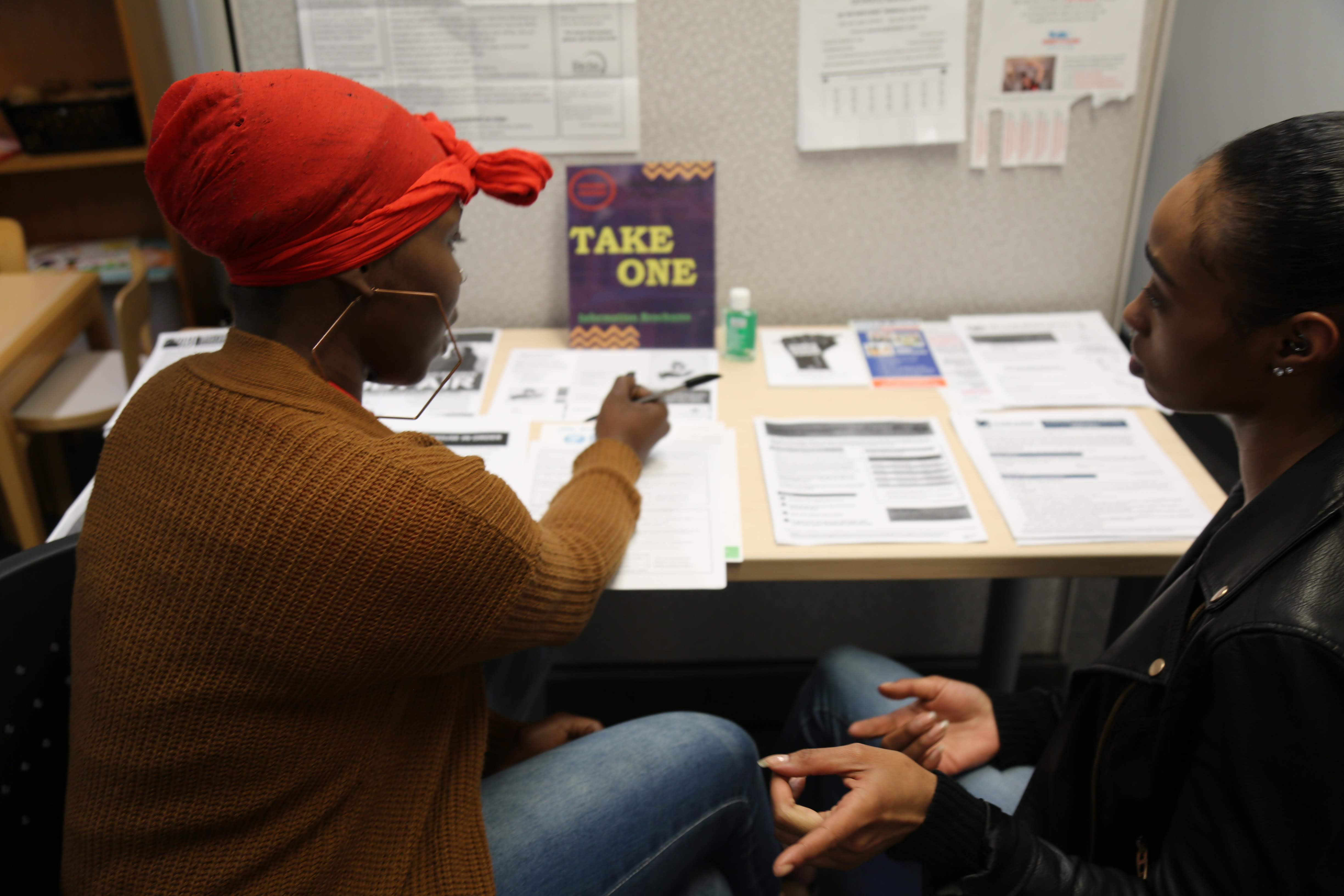Two women discuss options in our Urban League resource center