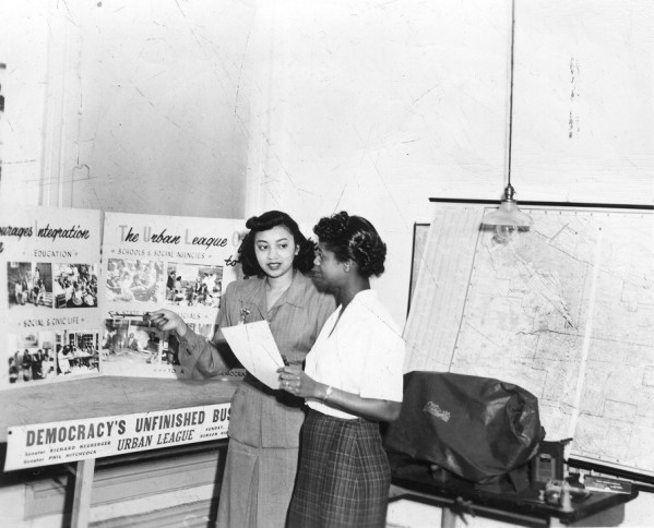 Myrtle White Carr and Gertrude Williams Rae with Urban League display 1956